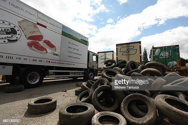 French farmers use tractors and tyres to form a blockade at the Europe bridge leading over the Rhine between Strasbourg and Kehl on the border to...