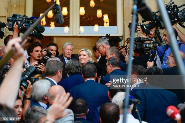 French farrigh Front National party's newly elected Member of Parliament Marine Le Pen looks on as she arrives on June 21 2017 at the French National...