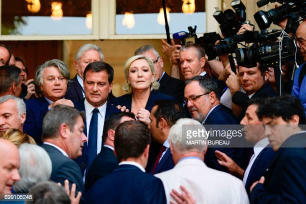 French farrigh Front National party's newly elected Members of Parliament Gilbert Collard Louis Aliot and Marine Le Pen pose as they arrive on June...