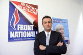 French farright Front National candidate Laurent Lopez poses at his campaign headquarters in Brignoles on October 7 2013 the day after he won the...