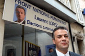 French farright Front National candidate Laurent Lopez poses in front of his campaign headquarters in Brignoles on October 7 2013 the day after he...