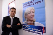French farright Front National candidate Laurent Lopez poses next to a poster of FN leader Marine Le Pen at his campaign headquarters in Brignoles on...