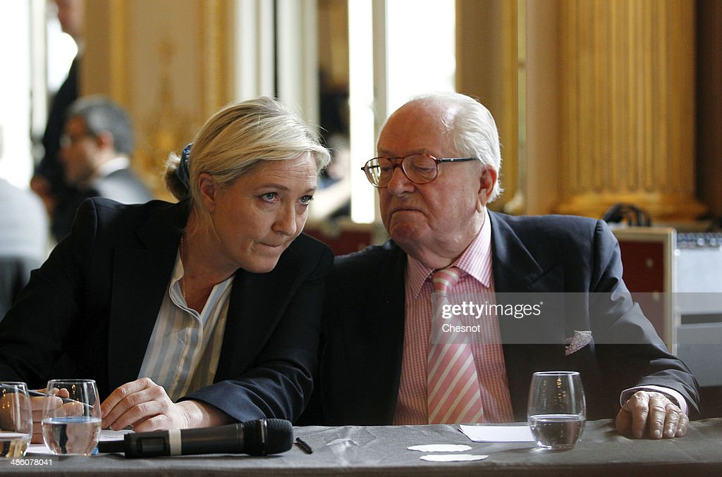 French far-right Front National (FN) founder and honorary President <a gi-track='captionPersonalityLinkClicked' href=/galleries/search?phrase=Jean-Marie+Le+Pen&family=editorial&specificpeople=214017 ng-click='$event.stopPropagation()'>Jean-Marie Le Pen</a> (R) and his daugther FN's party president <a gi-track='captionPersonalityLinkClicked' href=/galleries/search?phrase=Marine+Le+Pen&family=editorial&specificpeople=588282 ng-click='$event.stopPropagation()'>Marine Le Pen</a> attend a press conference to present their electoral campaign for the European elections on April 22, 2014 in Paris, France. The European Parliamentary elections will take place from May 22 to May 25, 2014, during which French far right parties are predicted to make significant gains.