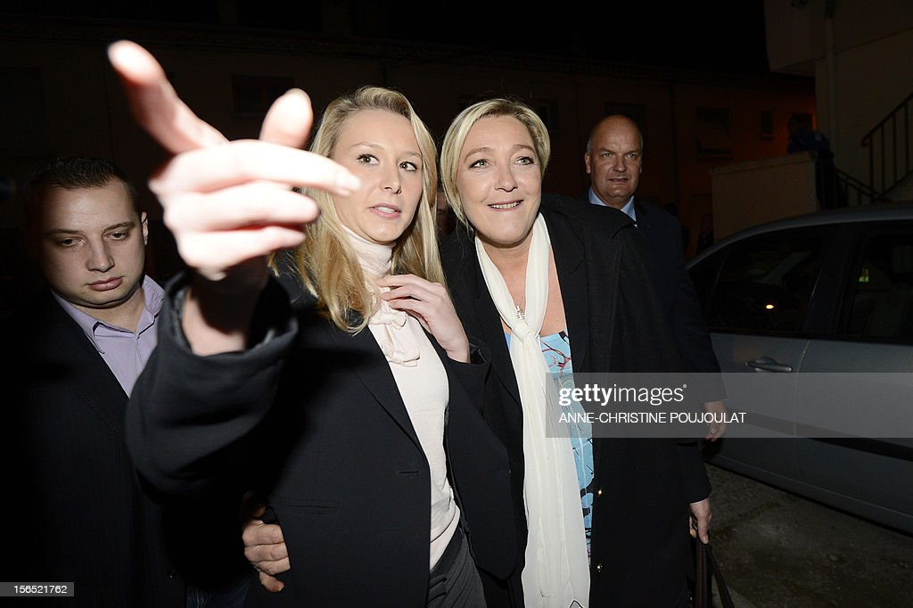 French far-right Front National (FN) MP Marion Marechal-Le Pen (2ndL) and her aunt Marine Le Pen, president of the party, arrive to inaugurate Marion's headquarters' on November 16, 2012 in Carpentras, southeastern France.