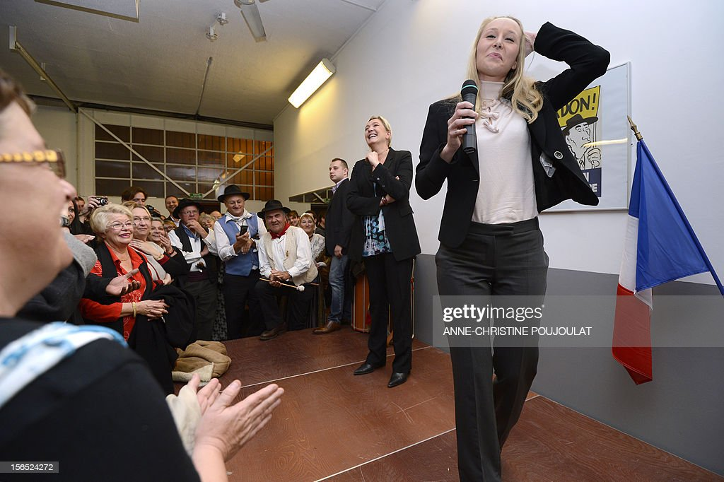 French far-right Front National (FN) MP Marion Marechal-Le Pen (R) and her aunt and party's president, Marine Le Pen, gesture during the inauguration of her office as deputy on November 16, 2012 in Carpentras, southeastern France.