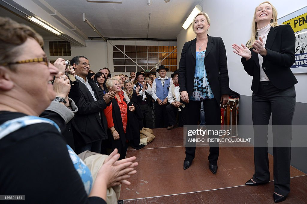 French far-right Front National (FN) MP Marion Marechal-Le Pen (R) applauds next to her aunt and party's president, Marine Le Pen, as she inaugurates her office as deputy on November 16, 2012 in Carpentras, southeastern France.