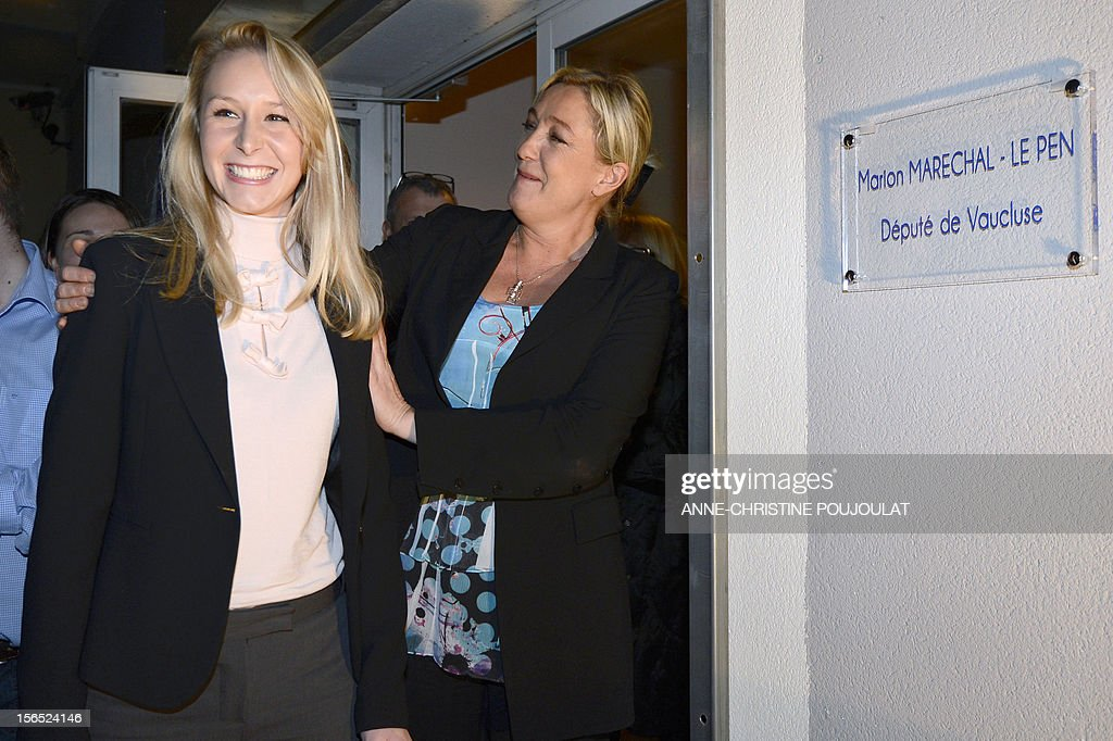 French far-right Front National (FN) MP Marion Marechal-Le Pen (L) is congratulated by her aunt and party's president, Marine Le Pen, as she inaugurates her office as deputy on November 16, 2012 in Carpentras, southeastern France. AFP PHOTO / ANNE-CHRISTINE POUJOULAT