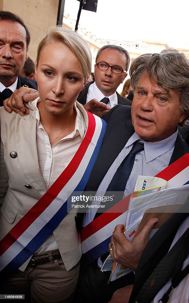 French far-right Front National (FN) newly elected two members of parliament, Marion Marechal Le Pen and Gilbert Collard, arrive at Assemblee Nationale on June 20, 2012 in Paris, France. The granddaughter of the FN party founder, Jean-Marie Le Pen, <a gi-track='captionPersonalityLinkClicked' href=/galleries/search?phrase=Marion+Marechal-Le+Pen&family=editorial&specificpeople=6562007 ng-click='$event.stopPropagation()'>Marion Marechal-Le Pen</a>, 22, is the youngest member ever elected to the Assembly of the Fifth Republic.