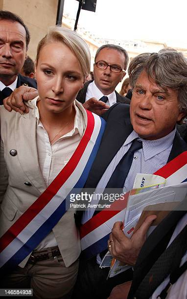 French farright Front National newly elected two members of parliament Marion Marechal Le Pen and Gilbert Collard arrive at Assemblee Nationale on...