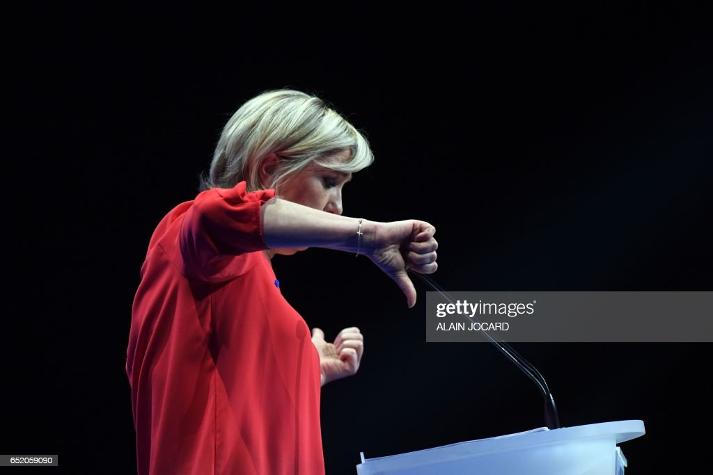 French far-right Front National (FN) party candidate for the presidential election Marine Le Pen gestures as she delivers a speech during a campaign rally on March 11, 2017 in Deols, central France. /