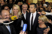 French farright Front National party candidate Laurent Lopez celebrates as he arrives at a polling station after winning the second round of a local...