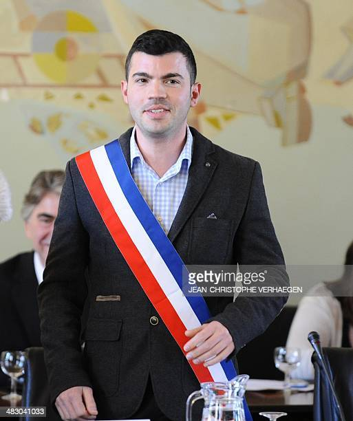 French farright Front National party member and newly elected mayor of Hayange Fabien Engelmann looks on after receiving his tricolour mayoral sash...