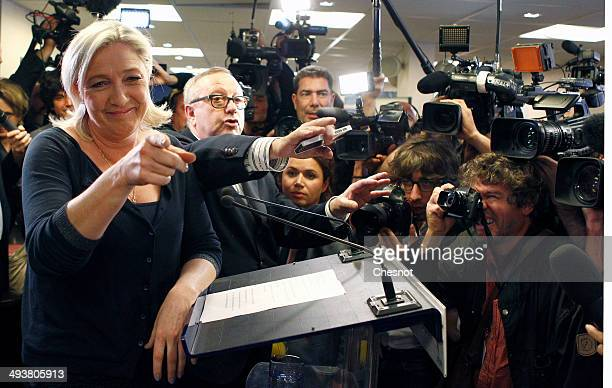 French farright Front National party president Marine Le Pen arrives to deliver a speech after the victory of her party in the European Elections on...