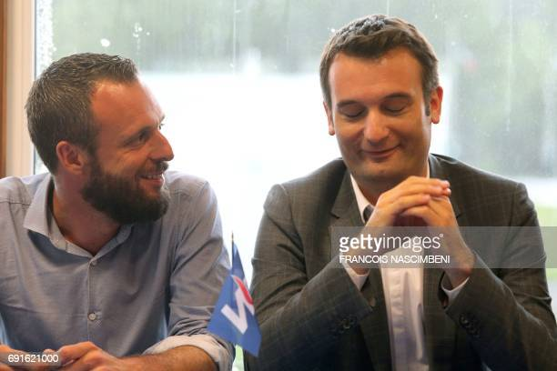 French farright Front National party VicePresident Florian Philippot sits next to his brother Damien Philippot candidate for the FN in the Aisne...