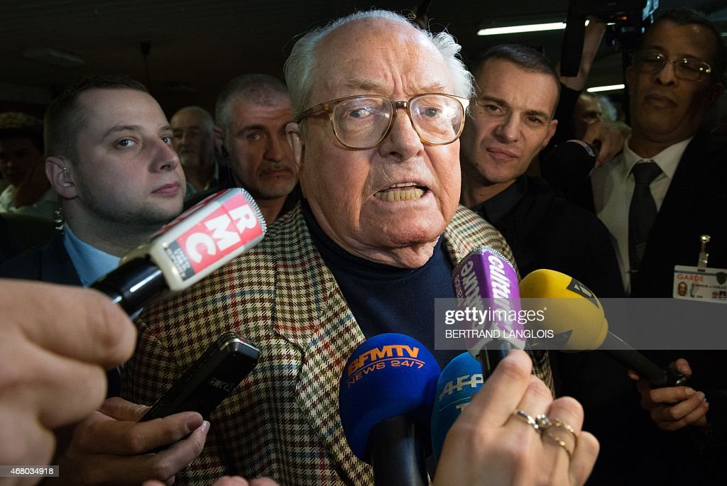 French far-right Front National (FN) party's honour president <a gi-track='captionPersonalityLinkClicked' href=/galleries/search?phrase=Jean-Marie+Le+Pen&family=editorial&specificpeople=214017 ng-click='$event.stopPropagation()'>Jean-Marie Le Pen</a> speaks to journalists as he arrives to listen to FN MP Marion Marechal-Le Pen, general secretary of the FN's Vaucluse department Federation, before the anouncement of the results of the second round of the French departementales elections in the Vaucluse county on March 29, 2015 in Carpentras, southern France. AFP PHOTO / BERTRAND LANGLOIS