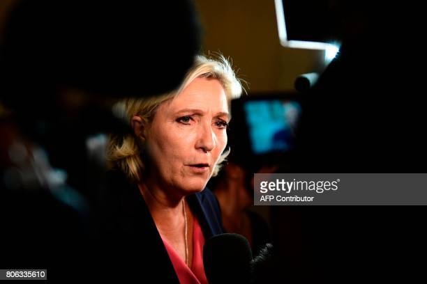 French farright Front National party's Member of Parliament Marine Le Pen answers the press after the French President gave a speech during a special...