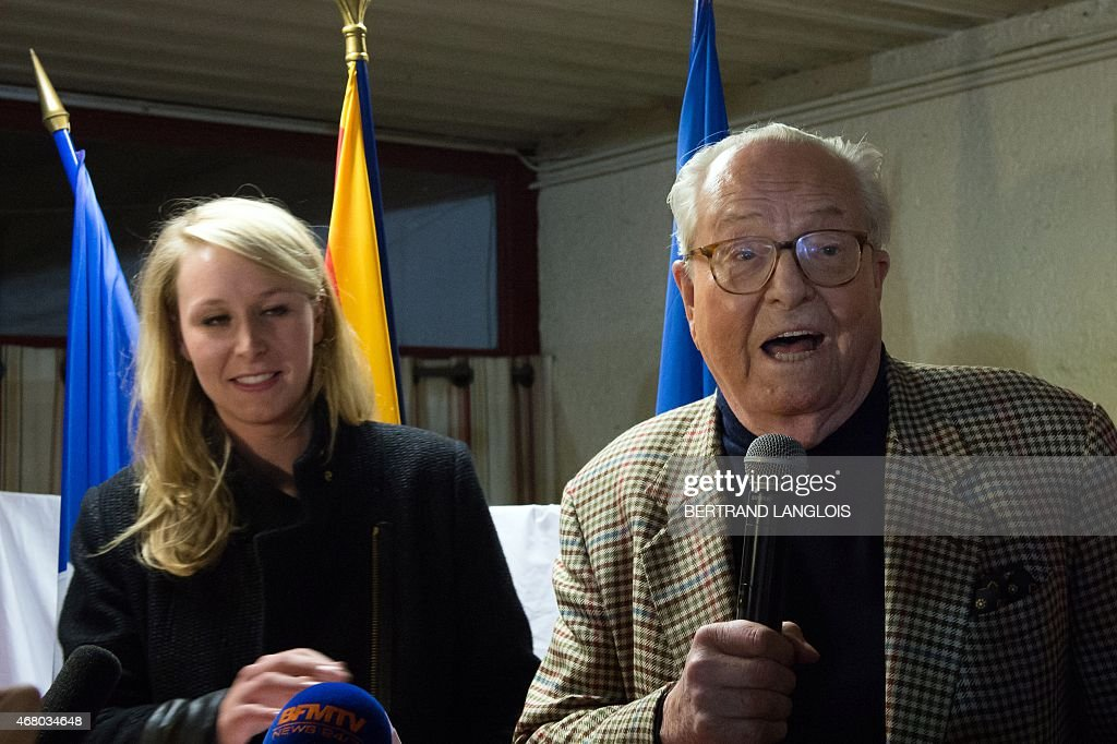 French far-right Front National (FN) party's MP <a gi-track='captionPersonalityLinkClicked' href=/galleries/search?phrase=Marion+Marechal-Le+Pen&family=editorial&specificpeople=6562007 ng-click='$event.stopPropagation()'>Marion Marechal-Le Pen</a> (L), general secretary of the FN's Vaucluse department Federation, and FN honour president <a gi-track='captionPersonalityLinkClicked' href=/galleries/search?phrase=Jean-Marie+Le+Pen&family=editorial&specificpeople=214017 ng-click='$event.stopPropagation()'>Jean-Marie Le Pen</a> (C) sing the national anthem following the anouncement of the results of the second round of the French departementales elections in the Vaucluse county on March 29, 2015 in Carpentras, southern France. AFP PHOTO / BERTRAND LANGLOIS