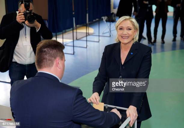 French farright Front National party's President Marine Le Pen casts her ballot for the French Presidential elections in a polling station on April...