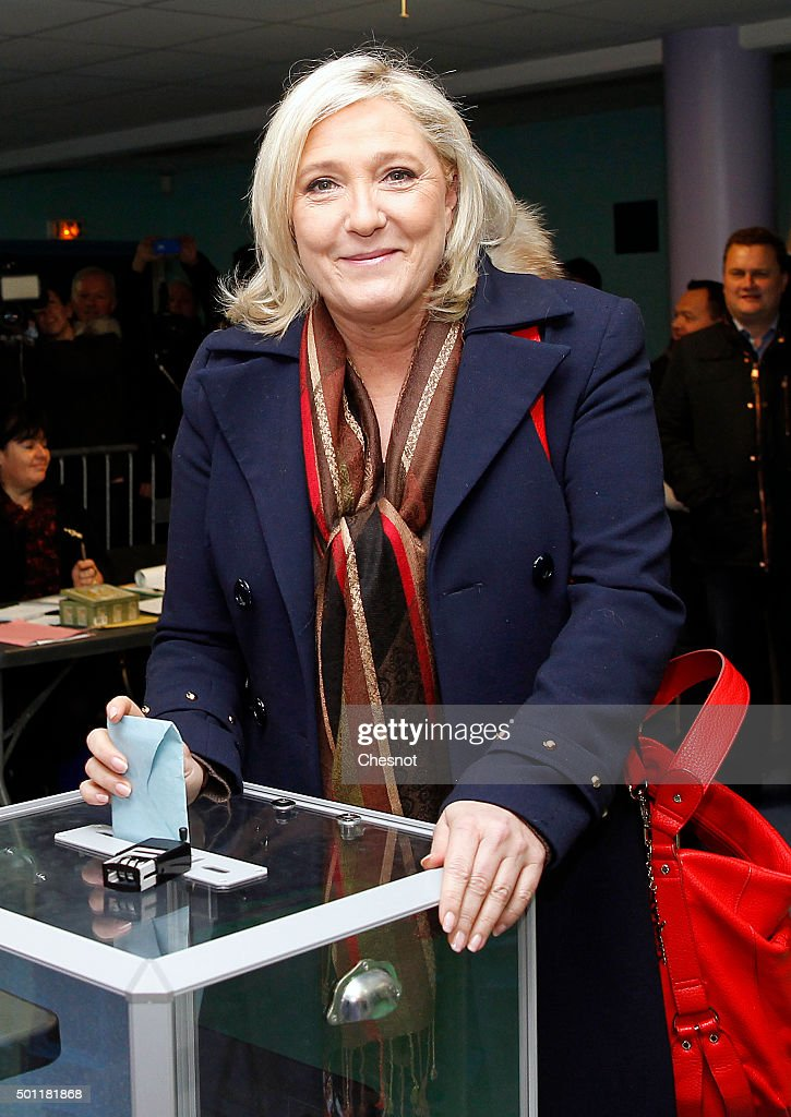 French far-right Front National (FN) party's President <a gi-track='captionPersonalityLinkClicked' href=/galleries/search?phrase=Marine+Le+Pen&family=editorial&specificpeople=588282 ng-click='$event.stopPropagation()'>Marine Le Pen</a>, candidate for the regional election in the Nord-Pas-de-Calais-Picardie region, casts her ballot on December 13, 2015 in Henin-Beaumont, France. France is holding its second round of the regional elections.