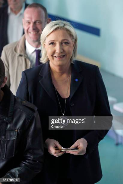 French farright Front National party's President Marine Le Pen is waiting before she votes in the first round of 2017 French presidential election at...