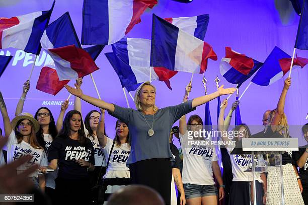 French farright Front National party's President Marine Le Pen acknowledges the audience on stage during the FN's summer congress in Frejus southern...