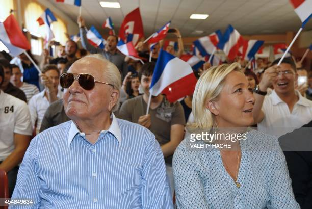 French farright leader Marine Le Pen and her father France's former farright leader JeanMarie Le Pen attend a youth summer congress of the Front...