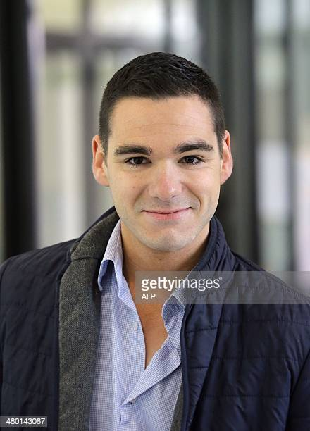 French farright National Front party candidate Etienne BousquetCassagne arrives to cast his ballot in the first round of the French municipal...
