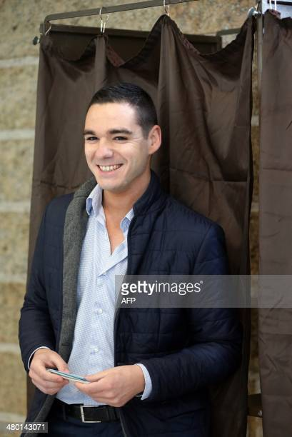 French farright National Front party candidate Etienne BousquetCassagne smiles as he steps out of a voting booth before casting his ballot in the...