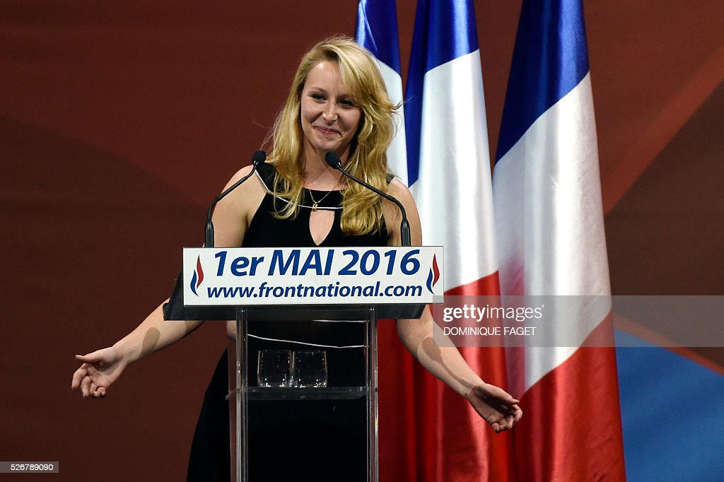French far-right National Front (Front National - FN) party member of parliament Marion Marechal-Le Pen delivers a speech during a party lunch in Paris on May 1, 2016.