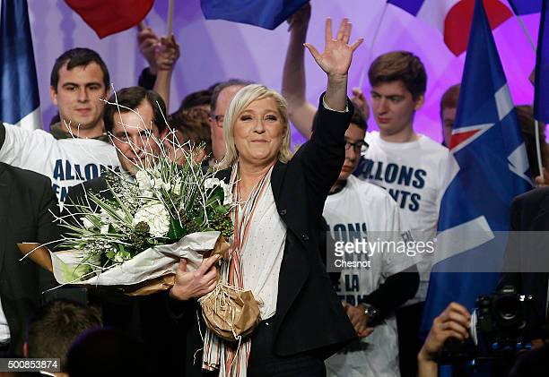French farright National Front President and candidate in the NordPasdeCalais Picardie region Marine Le Pen waves to supporters at the end of a...