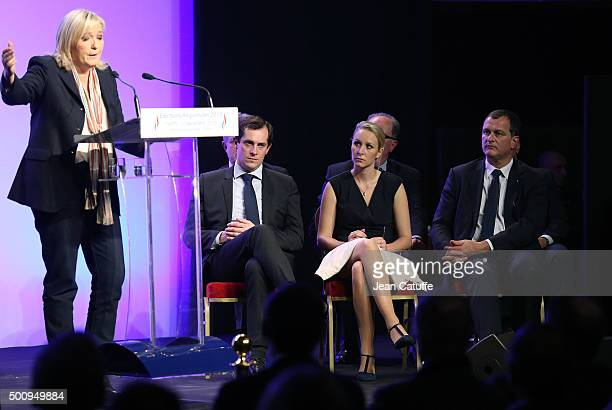 French farright National Front President and candidate in the NordPasdeCalais Picardie region Marine Le Pen speaks while regional candidates Nicolas...