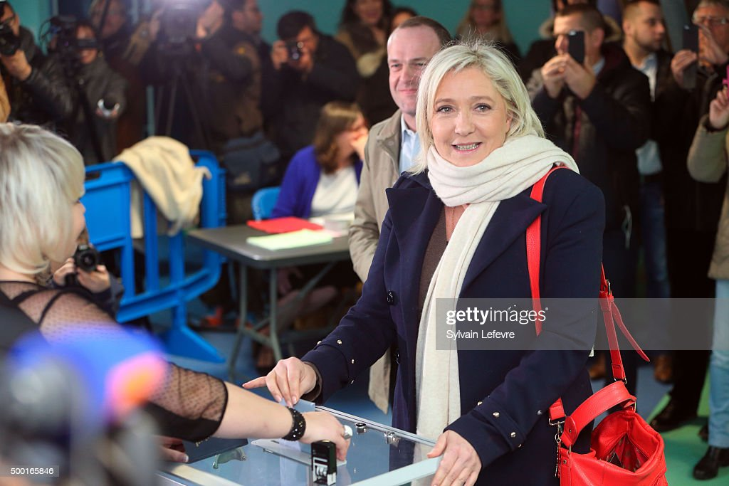 French FarRight National Front President Marine Le Pen prepares to vote in for the first round of regional elections on December 6 2015 in...