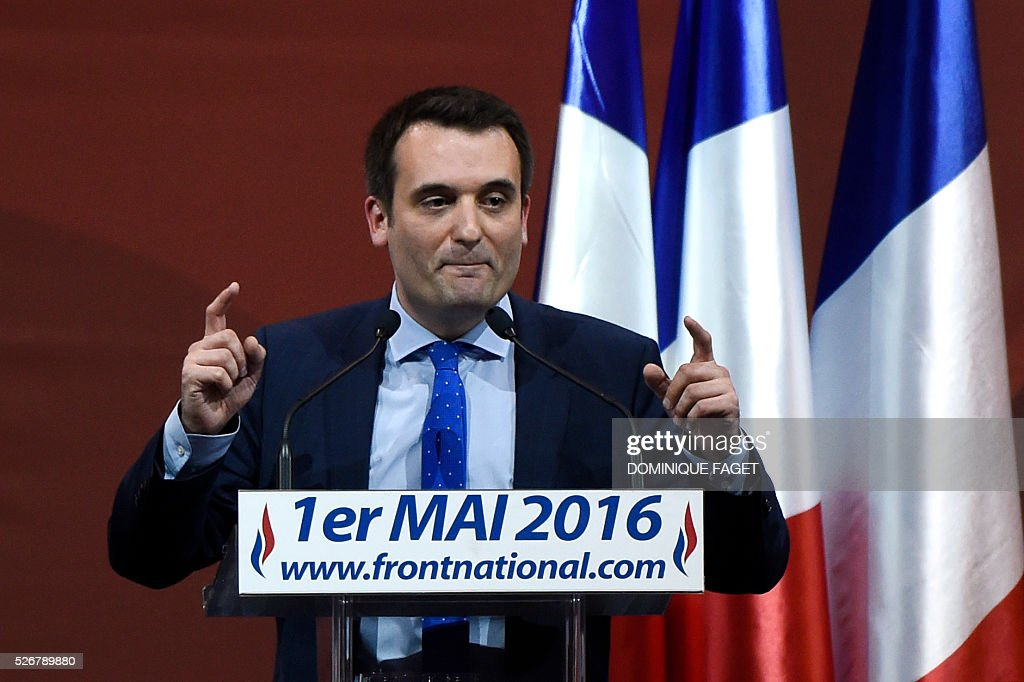French far-right National Front (Front National - FN) vice-president Florian Philippot delivers a speech during a party lunch in Paris on May 1, 2016.