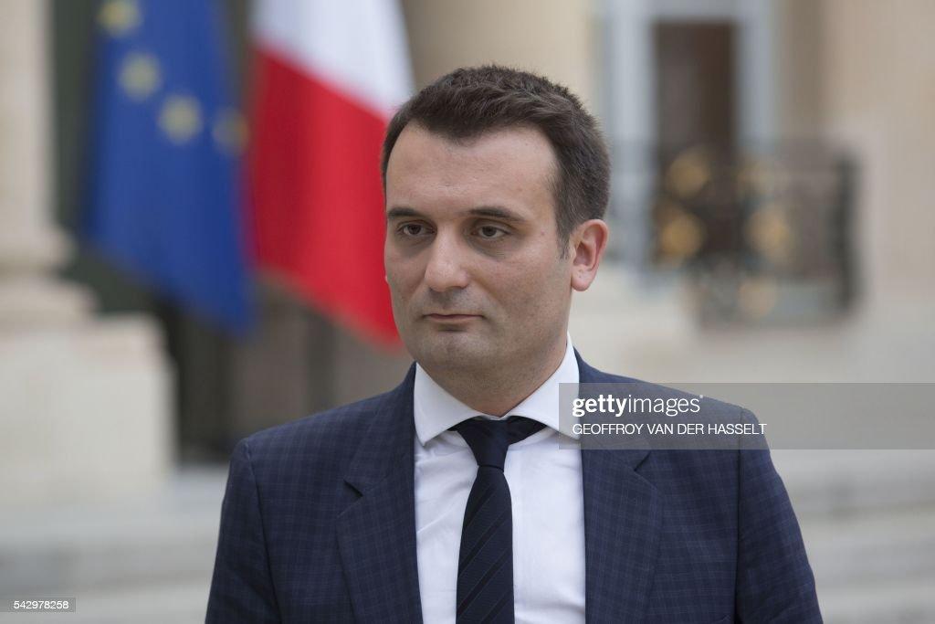 French far-right National Front (Front National - FN) vice-president Florian Philippot listens to FN party leader making a statement after a meeting with French President on June 25, 2016 at the Elysee Palace in Paris, after Britain voted to leave the European Union a day before. Europe's press was awash with gloom and doom over Brexit on June 25, warning that it was a boon for nationalists while urging EU leaders to meet the challenge of their 'rendezvous with history'. / AFP / GEOFFROY
