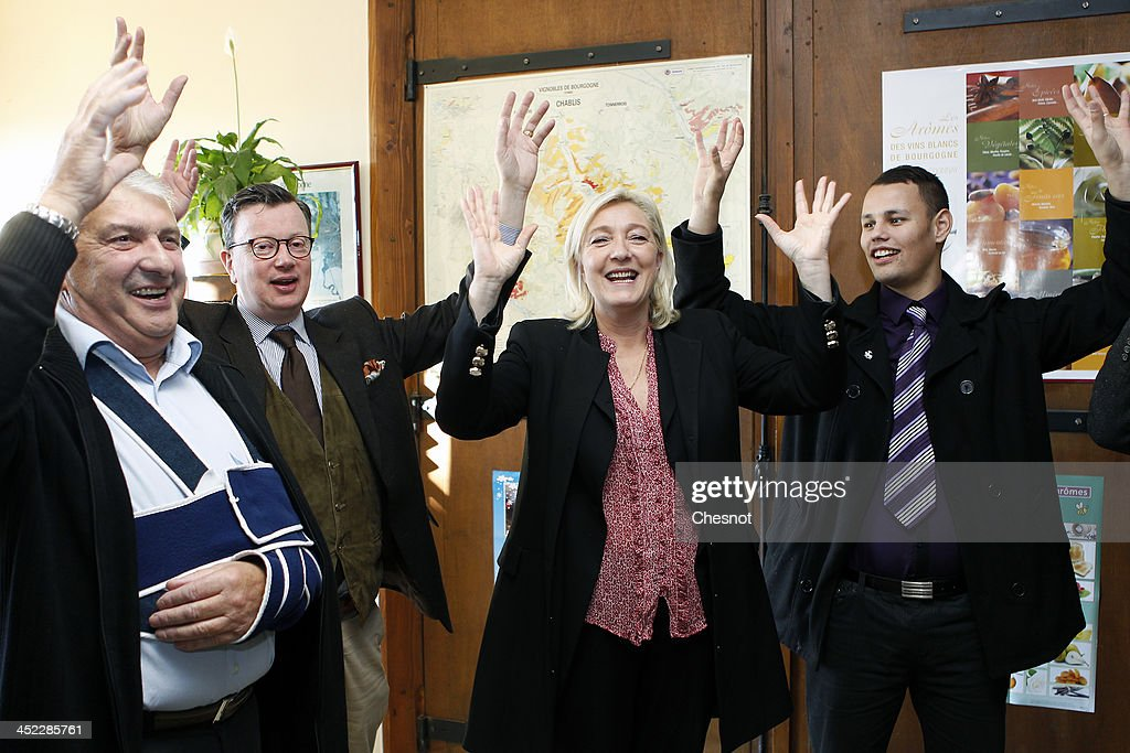 French farright National Front's Leader Marine Le Pen sings during her visit in a vineyard on November 27 2013 in Sens France