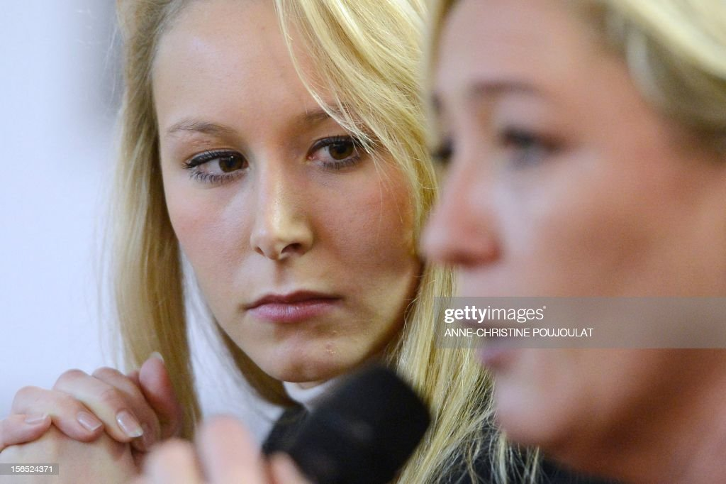 French far-right party Front National (FN) MP Marion Marechal-Le Pen (L) listens to her aunt and party's president Marine Le Pen's (R) speech during a press conference as part of the inauguration of her office as deputy on November 16, 2012 in Carpentras, southeastern France.
