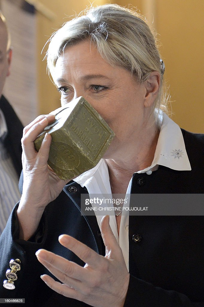 French far-right party Front National (FN) president Marine Le Pen smells a soap bar as she visits 'Le Fer à Cheval' savon de Marseille (Marseille's soap) factory on February 1, 2013 in Marseille, southeastern France. 'Le Fer à Cheval' soap factory is currently pursuing a recovery plan.