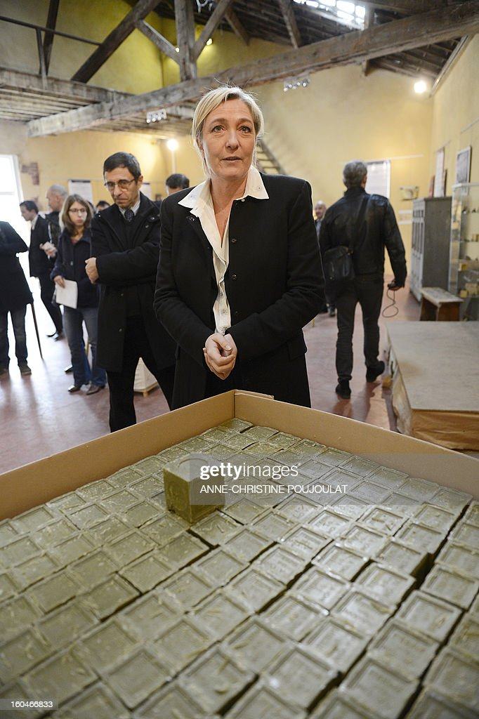 French far-right party Front National (FN) president Marine Le Pen visits 'Le Fer à Cheval' savon de Marseille (Marseille's soap) factory on February 1, 2013 in Marseille, southeastern France. 'Le Fer à Cheval' soap factory is currently pursuing a recovery plan.