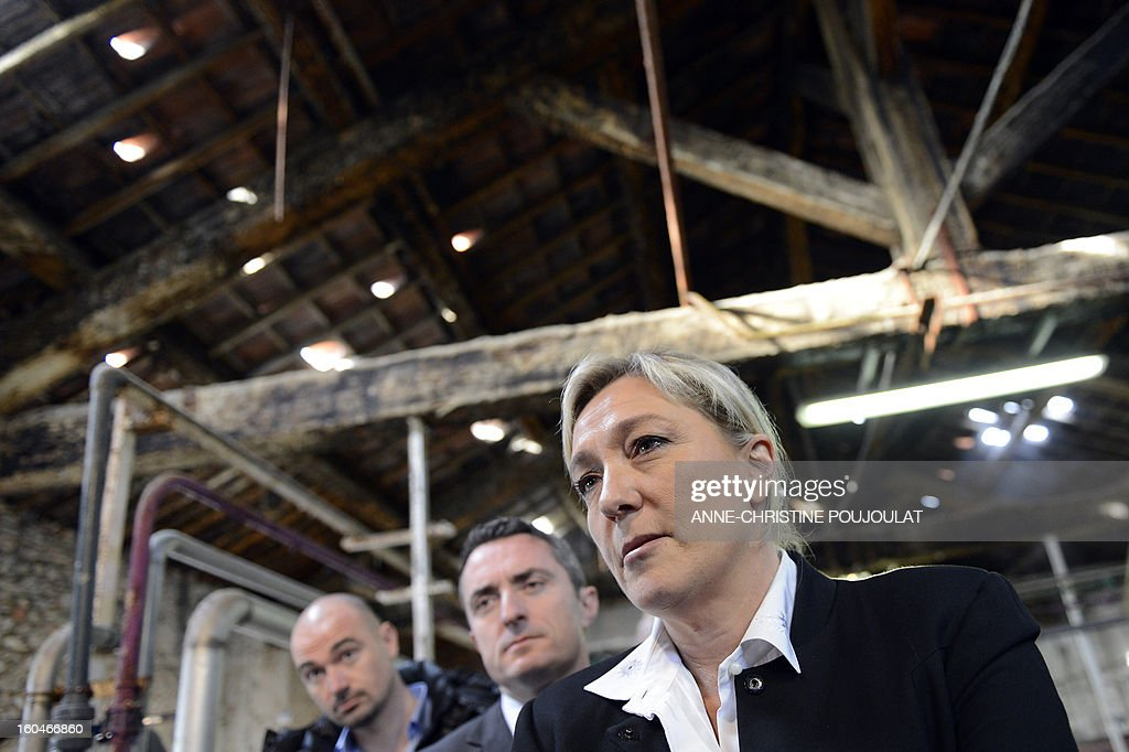 French far-right party Front National (FN) president Marine Le Pen visits 'Le Fer à Cheval' savon de Marseille (Marseille's soap) factory on February 1, 2013 in Marseille, southeastern France. 'Le Fer à Cheval' soap factory is currently pursuing a recovery plan. AFP PHOTO / ANNE-CHRISTINE POUJOULAT