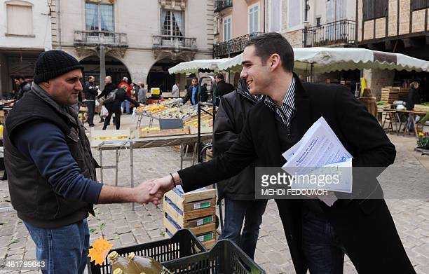French farright party Front national's candidate for the 2014 mayoral election Etienne BousquetCassagne meets people on a market on January 11 2014...