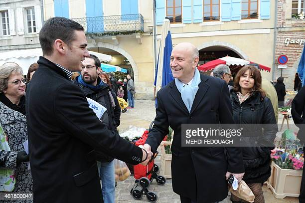 French farright party Front national's candidate for the 2014 mayoral election Etienne BousquetCassagne meets rightwing UMP party's candidate Renaud...