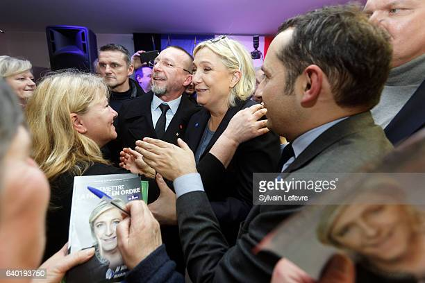 French farright party National Front leader Marine Le Pen meets activists after a private meeting with FN activists on January 27 2017 in Haulchin...