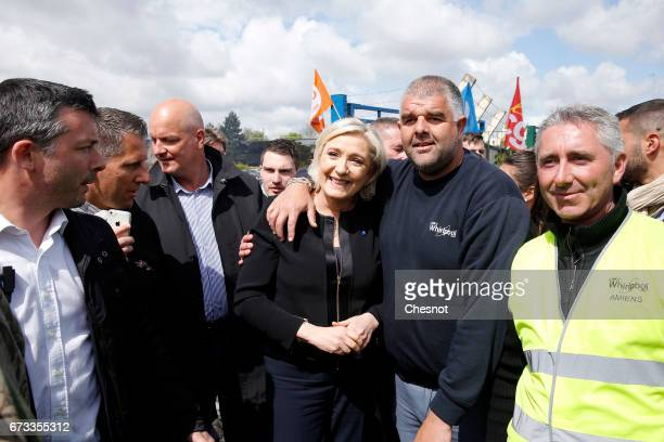 French farright political party National Front and President French presidential election candidate Marine Le Pen poses for selfies with strike...