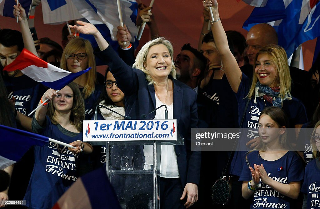 French farright political party National Front leader Marine Le Pen waves after her speech during the party's traditional Joan of Arc May Day rally...