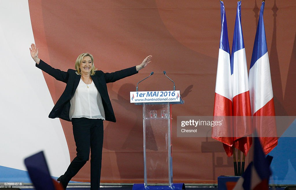 French far-right political party National Front (FN) leader <a gi-track='captionPersonalityLinkClicked' href=/galleries/search?phrase=Marine+Le+Pen&family=editorial&specificpeople=588282 ng-click='$event.stopPropagation()'>Marine Le Pen</a> arrives to deliver a speech during the party's traditional Joan of Arc (Jeanne d'Arc) May Day rally on May 1, 2016 in Paris, France. Labor Day or May Day is observed all over the world on the first day of the May to celebrate the economic and social achievements of workers and to fight for laborers rights.