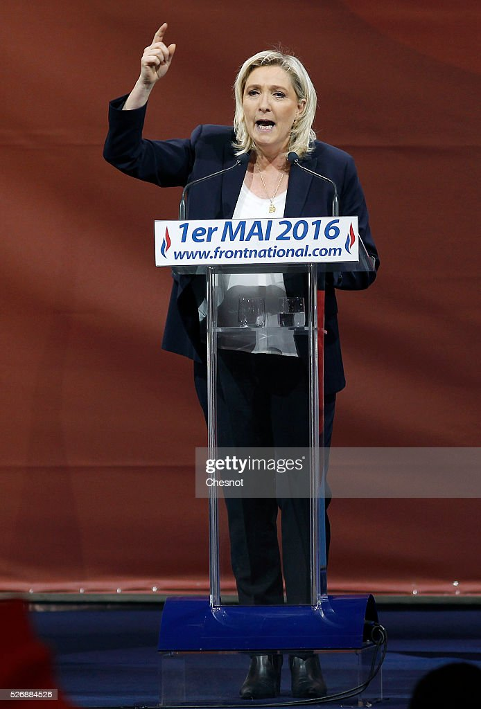 French far-right political party National Front (FN) leader <a gi-track='captionPersonalityLinkClicked' href=/galleries/search?phrase=Marine+Le+Pen&family=editorial&specificpeople=588282 ng-click='$event.stopPropagation()'>Marine Le Pen</a> delivers a speech during the party's traditional Joan of Arc (Jeanne d'Arc) May Day rally on May 1, 2016 in Paris, France. Labor Day or May Day is observed all over the world on the first day of the May to celebrate the economic and social achievements of workers and to fight for laborers rights.