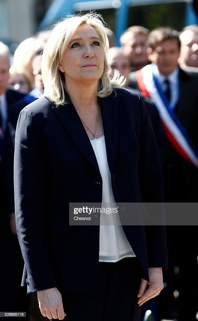 French far-right political party National Front (FN) leader <a gi-track='captionPersonalityLinkClicked' href=/galleries/search?phrase=Marine+Le+Pen&family=editorial&specificpeople=588282 ng-click='$event.stopPropagation()'>Marine Le Pen</a> takes part in the party's traditional Joan of Arc (Jeanne d��Arc) May Day rally at the Jeanne d Arc statue in Saint Augustin Square on May 1, 2016 in Paris, France. Labor Day or May Day is observed all over the world on the first day of the May to celebrate the economic and social achievements of workers and to fight for laborers' rights.