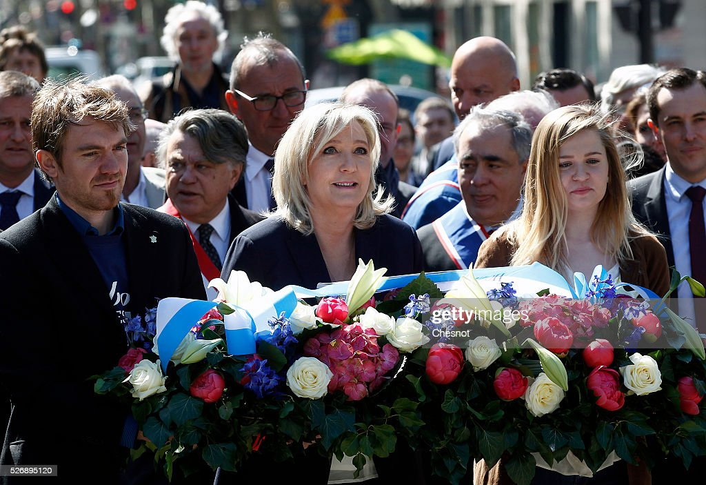 French far-right political party National Front (FN) leader <a gi-track='captionPersonalityLinkClicked' href=/galleries/search?phrase=Marine+Le+Pen&family=editorial&specificpeople=588282 ng-click='$event.stopPropagation()'>Marine Le Pen</a> lays a wreath at the statue of Joan of Arc (Jeanne d'Arc) during the party's traditional May Day rally on May 1, 2016 in Paris, France. Labor Day or May Day is observed all over the world on the first day of the May to celebrate the economic and social achievements of workers and to fight for laborers' rights.