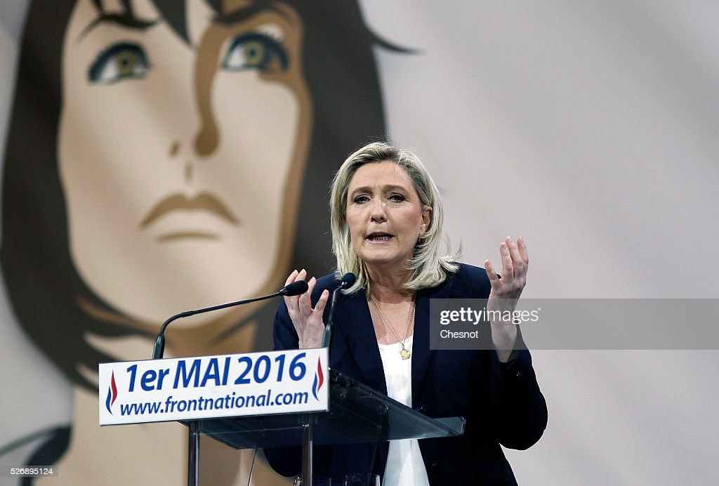 French far-right political party National Front (FN) leader <a gi-track='captionPersonalityLinkClicked' href=/galleries/search?phrase=Marine+Le+Pen&family=editorial&specificpeople=588282 ng-click='$event.stopPropagation()'>Marine Le Pen</a> delivers a speech during the party's traditional Joan of Arc (Jeanne d'Arc) May Day rally on May 1, 2016 in Paris, France. Labor Day or May Day is observed all over the world on the first day of the May to celebrate the economic and social achievements of workers and to fight for laborers' rights.