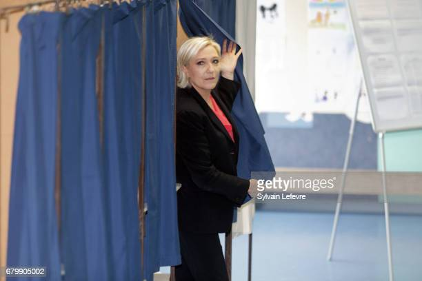 French farright presidential candidate Marine Le Pen exits a polling booth as she votes for the 2nd round in a polling station on May 7 2017 in...